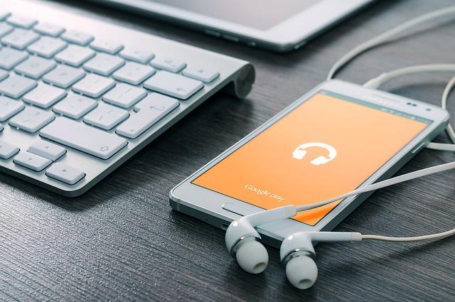 mobil se sluchátky